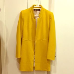 Yellow coat from Zara. Never worn. Tag attached.